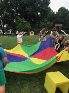 Children using parachute to play games